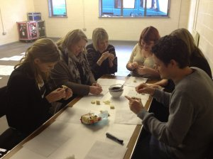 The New Perspectives team taking part in Little Earthquake's workshop... making marzipan bees!